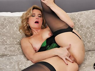 Naughty mature Alby Daor opens her legs to masturbate on the bed